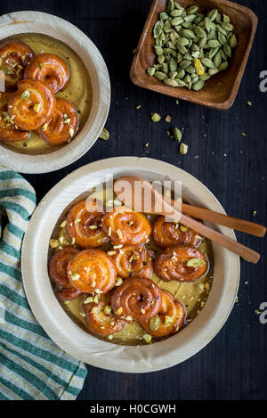 Speacial cake on white bowl or chanar jilipi panee jalebi on the table - Stock Photo