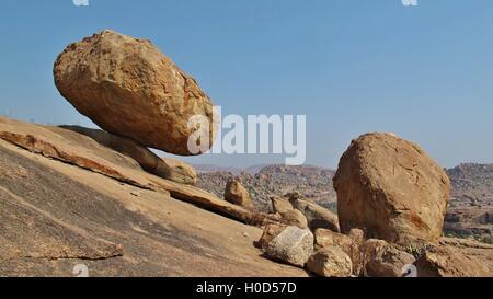 Big balancing granite boulder in Hampi, India. Popular region for rock climbing. Unique landscape. - Stock Photo