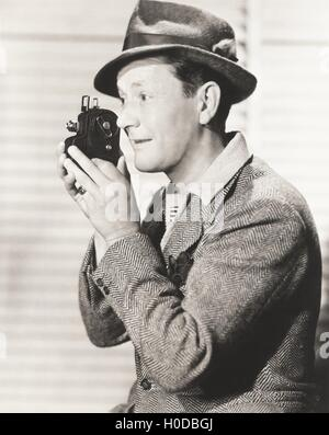 Man filming home movie - Stock Photo