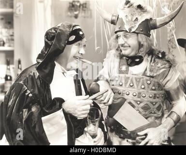 Two men at a costume party - Stock Photo