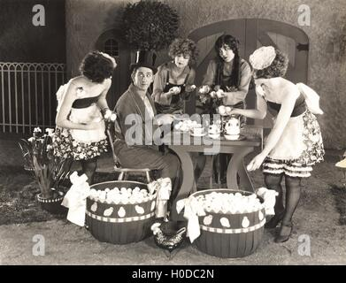 Young women offering an abundance of eggs to man - Stock Photo