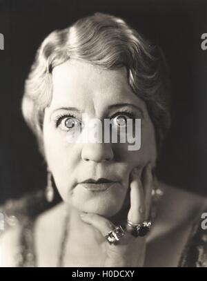 Portrait of wide-eyed woman - Stock Photo