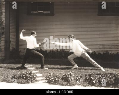 Two men fencing - Stock Photo