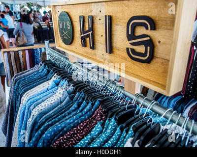 Mens shirts on sale in a market stall - Stock Photo