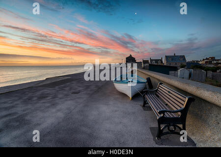Stunning sunset at Chesil Cove in Portland, on the easter edge of Chesil Beach on Dorset's Jurassic coast - Stock Photo