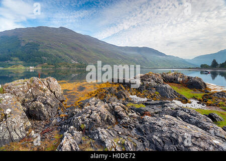 A misty morning on the shores of Loch Duich in the Highlands of Scotland - Stock Photo