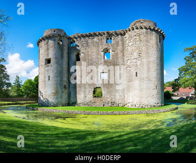 The moated medieval castle at the village of Nunney in Somerset - Stock Photo