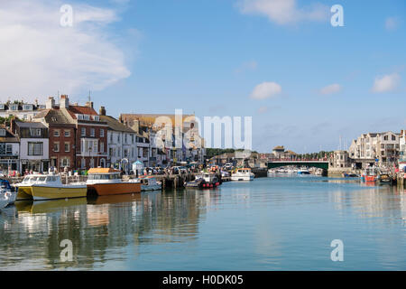 View to Weymouth Town Bridge across outer harbour on River Wey. Melcombe Regis, Weymouth, Dorset, England, UK, Britain - Stock Photo