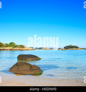 Ploumanach, rock and bay beach in morning. Pink granite coast, Perros Guirec, Brittany, France. - Stock Photo