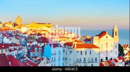 Sunset view of Alfama district - Old Town of Lisbon. Portugal - Stock Photo