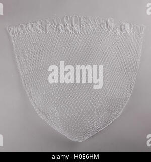Harvest gear of white cloth mesh for fishing on grey background - Stock Photo