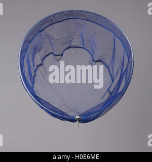 Harvest gear of blue cloth mesh for fishing on grey background - Stock Photo