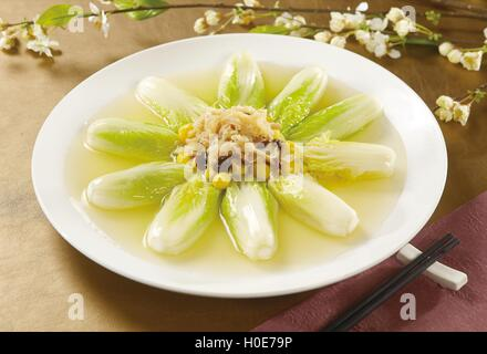 Scallops white ginkgo Tianjin with cabbage on white plate in restaurant - Stock Photo