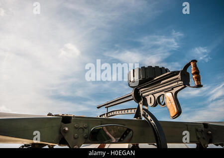 A replica gun on the top wing of a replica SE5a World War One fighter plane. The gun is drum fed and can be reloaded - Stock Photo