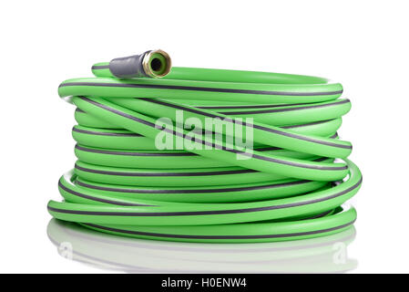 Long garden hose rolled-up isolated on white background - Stock Photo