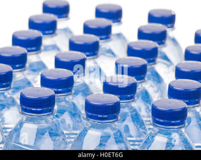 Rows of water bottles isolated on white background - Stock Photo