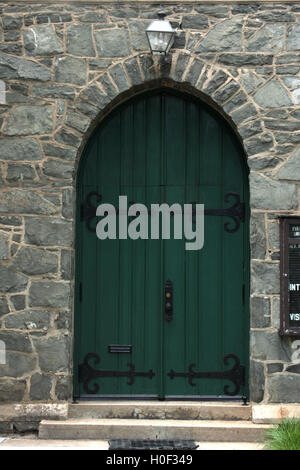 Green old wooden door at historic building in Lynchburg, Virginia - Stock Photo