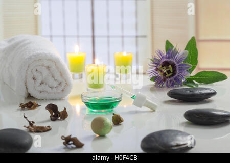 Aromatherapy votive candles burning with a soft glowing flame for wellness treatment in spa - Stock Photo