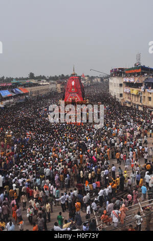 Puri, Odisha, India- July 3, 2011: Massive chariot of Lord Balbhadra surrounded by thousands of enthused pilgrims - Stock Photo