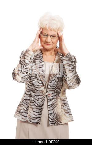 An old elegant lady is having a headache. - Stock Photo