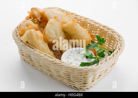 Cod in beer batter with tartar sauce in bamboo basket on white background - Stock Photo