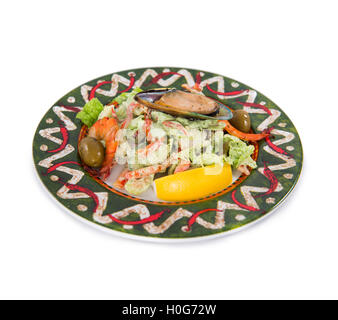 Mexican style of salads with fish, seafood, shrimp, lemon clams and olive on white background - Stock Photo
