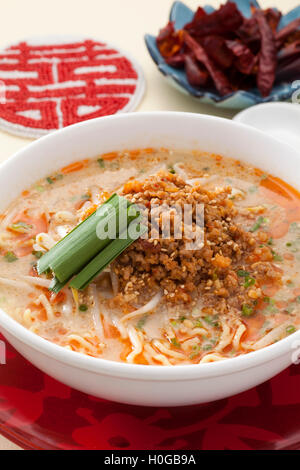 Dandan noodles with sprout and minced pork in Chinese style - Stock Photo