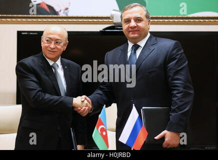 Baku, Azerbaijan. 20th Sep, 2016. Azerbaijan's minister of emergency situations Kamaladdin Heydarov (L) and Russia's - Stock Photo
