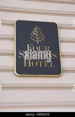 Wall sign for the Four Seasons Hotel in Prague Czech Republic - Stock Photo