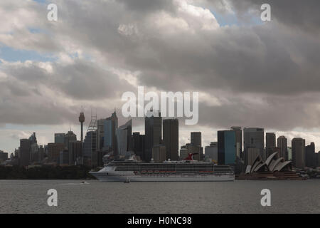 The Carnival Spirit Cruise Ship passes directly in front of the Sydney CBD as she departs Sydney Australia - Stock Photo