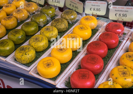 Colourful Dutch Gouda cheese displayed on a market stall, Waterloopleinmarkt, Amsterdam, Netherlands - Stock Photo