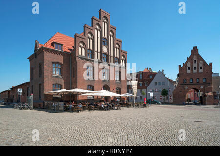Old customs house with water gate in the Old Port, Wismar, Mecklenburg-Western Pomerania, Germany - Stock Photo