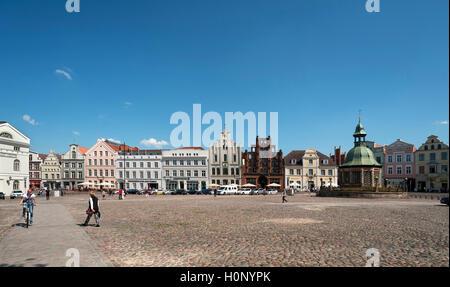 Historic buildings on the market square, Wismar Wasserkunst, Mecklenburg-Western Pomerania, Germany - Stock Photo
