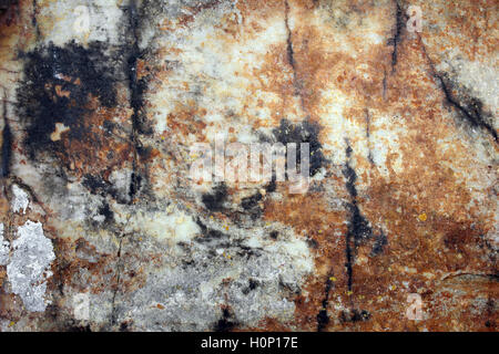 Rock With Iron Oxide and Manganese Staining - Stock Photo