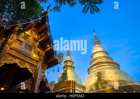 Dusk View of the Wat Phra Singh temple, the most revered temple in Chiang Mai, Thailand. - Stock Photo