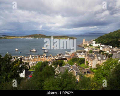 View Over the Bay to the Isle of Kerrera and Mull from McCaigs Tower above Oban Argyll and Bute Scotland - Stock Photo