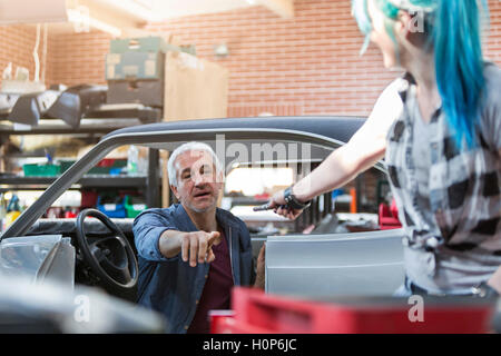 mechanic reaching tool auto repair shop - Stock Photo