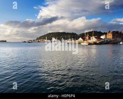 View across Oban Bay to North Pier at Sunset Oban Argyll and Bute Scotland - Stock Photo