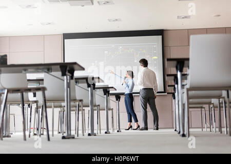 businesswoman meeting projection screen - Stock Photo