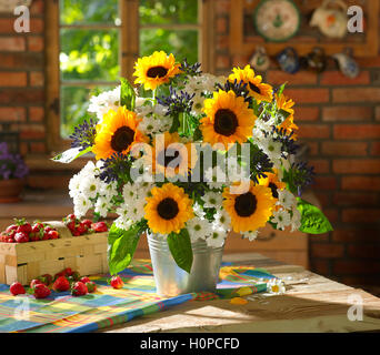 Bouquet of flowers including sunflowers, chrysanthemums. - Stock Photo