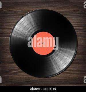 Old vinyl record on dark wooden table. - Stock Photo