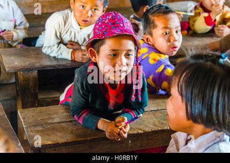 Boy sitting at desk, pupil at school, Shan State, Myanmar - Stock Photo