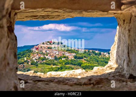 Town of Motovun on pictoresque hill of Istria through stone window, Croatia - Stock Photo