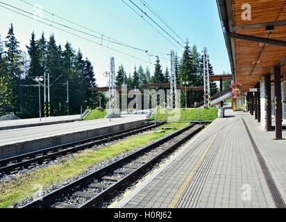 Empty platforms without trains and people at terminal railway station Strbske pleso in High Tatras, Slovakia. - Stock Photo