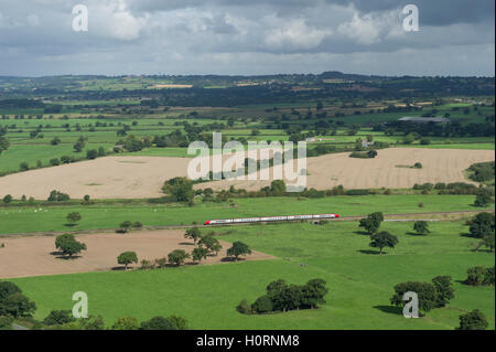 A Virgin Train travelling through the Cheshire countryside between Chester and Crewe - Stock Photo