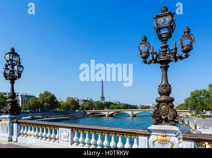 The River Seine and Eiffel Tower (Tour Eiffel) from Alexander III Bridge (Pont Alexandre III), Paris, France - Stock Photo