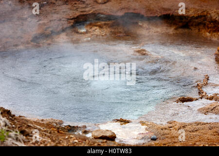 water boiling and steam rising in a hot springs geyser geysir Iceland - Stock Photo