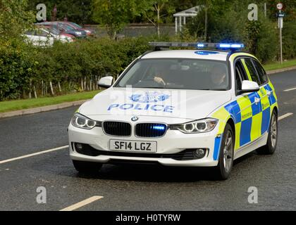 A Police Scotland BMW car with blue flashing lights - Stock Photo