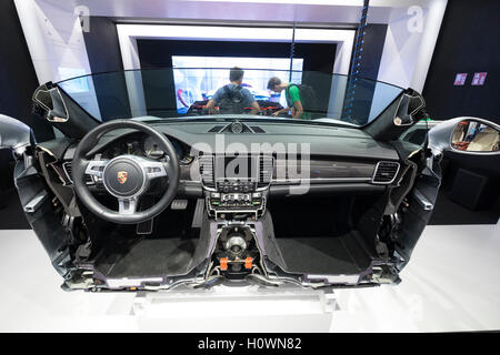 Display of modern car manufacture and assembly production line at VW Volkswagen Visitor Centre at Autostadt in Wolfsburg, - Stock Photo