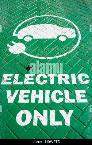 Sign on parking bay at electric vehicle charging point - Stock Photo